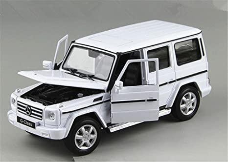 amazoncom welly mercedes g class g55 amg 124 scale pre built diecast model car white toys games