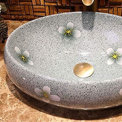 バスルームオーバル洗面レトロセラミックホテルアンチスプラッシュ洗面浴室のシンクの蛇口1セット