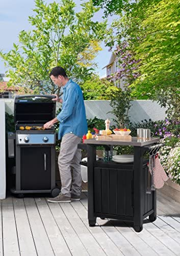 61cWpfXKq9L. AC Keter Unity Portable Outdoor Table and Storage Cabinet with Hooks for Grill Accessories-Stainless Steel Top for Patio Kitchen Island or Bar Cart, Dark Grey    This plastic outdoor kitchen storage table with wheels combines two storage solutions in one, providing a stainless steel top for serving drinks or condiments and a cupboard for storing extra supplies. It works perfectly for a family barbecue or any friendly gatherings on the deck, giving you extra serving and storage space for plates, water bottles and more. Place snacks on the durable surface for friends to grab any time, and keep cloth napkins or grilling utensils hung easily within reach on the additional hooks.