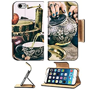 Luxlady Premium Apple iPhone 6 iPhone 6S Flip Pu Leather Wallet Case IMAGE ID: 33780717 Pouring tea from teapot on old retro wooden table Woman pouring tea in vintage style