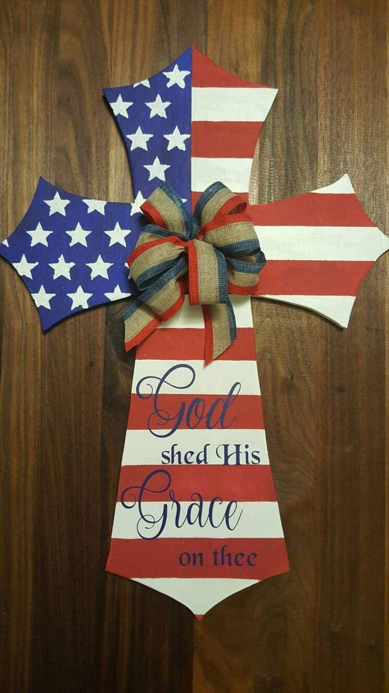 CELYCASY Patriotic American Flag Cross Door Hanger, God Shed His Grace on Thee, with red, White and Blue Burlap Bow, Wooden Cross, God Bless America