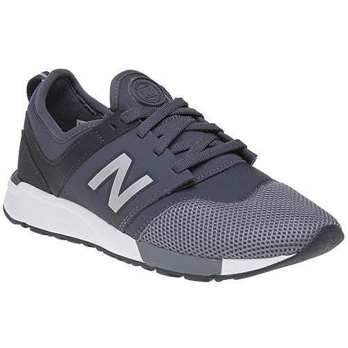 b706aa8318a New Balance 247 Niño Zapatillas Gris  Amazon.es  Zapatos y complementos