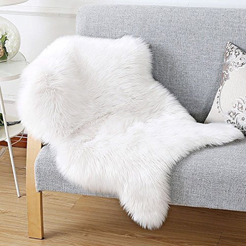 - HAOCOO Faux Fur Rug White Shag Fuzzy Fluffy Sheepskin Kids Carpet with Super Fluffy Thick,Used As an Area Rug in Bedroom,Living Room Or Across Your Armchair Or Couch. 2ft. x 3ft. (Ivory White)