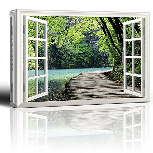 White Window Looking Out Into a Bridge by a Lake Surrounded by Trees