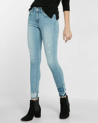 a6d65b87bee7e Image Unavailable. Image not available for. Color: Express Mid Rise Frayed  Tier Hem Stretch+Performance Ankle Jean ...