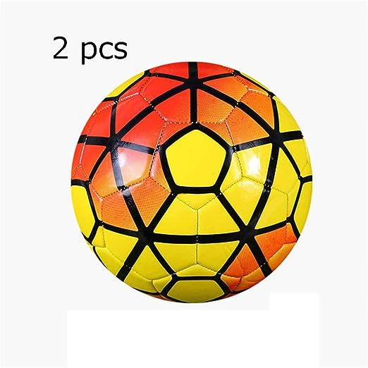 Los niños practican la pelota de fútbol 2 unids de los niños de ...
