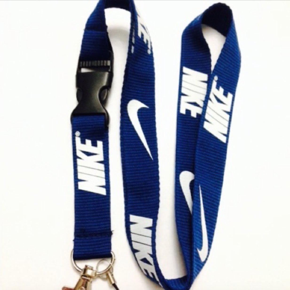 Nike azul oscuro llavero Lanyard: Amazon.es: Deportes y aire ...