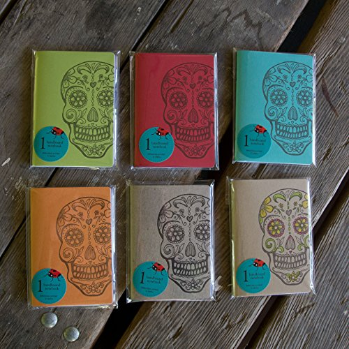 (Sugar Skull Notebooks, hand drawn and staple bound, letterpress printed eco friendly)