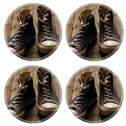 MSD Round Coasters Non-Slip Natural Rubber Desk Coasters design: 34965140 Dirty gumshoes on wooden background -