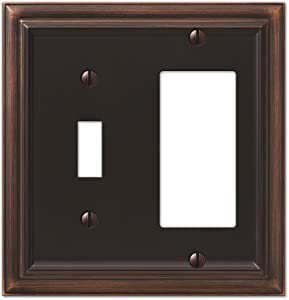 Amerelle Continental Single Toggle/Single Rocker Cast Metal Wallplate in Aged Bronze