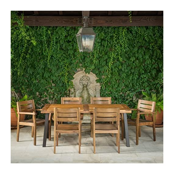 Christopher Knight Home 301108 Avalon 7 Piece Acacia Wood Dining Set with Rustic Metal Accents, Teak Finish - Includes: one (1) Table and six (6) chairs Table dimensions: 32. 25 inches deep x 69. 00 inches wide x 29. 50 inches high Chair dimensions: 22. 75 inches deep x 22. 75 inches wide x 33. 25 inches high Seat width: 17. 75 inches Seat Depth: 18. 75 inches Seat Height: 17. 75 inches Arm Height: 26. 25 inches Material: Acacia wood | Table leg finish: rustic metal - patio-furniture, dining-sets-patio-funiture, patio - 61diKdUh8wL. SS570  -