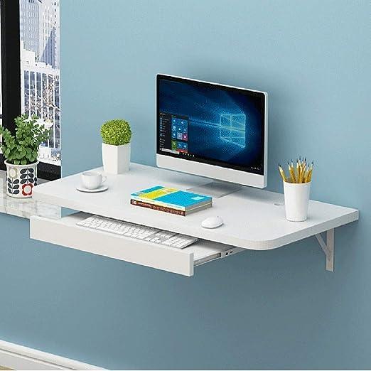 Escritorio montado en la pared del ordenador portátil de la ...
