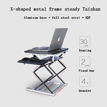 Mesa de ordenador El puede ser elevado y bajado. La mesa de la oficina está de ...