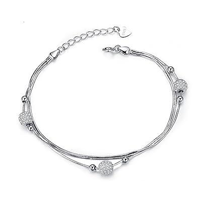 Bracelet avec trois petites boules incrusté de pierre rond sur chaîne.