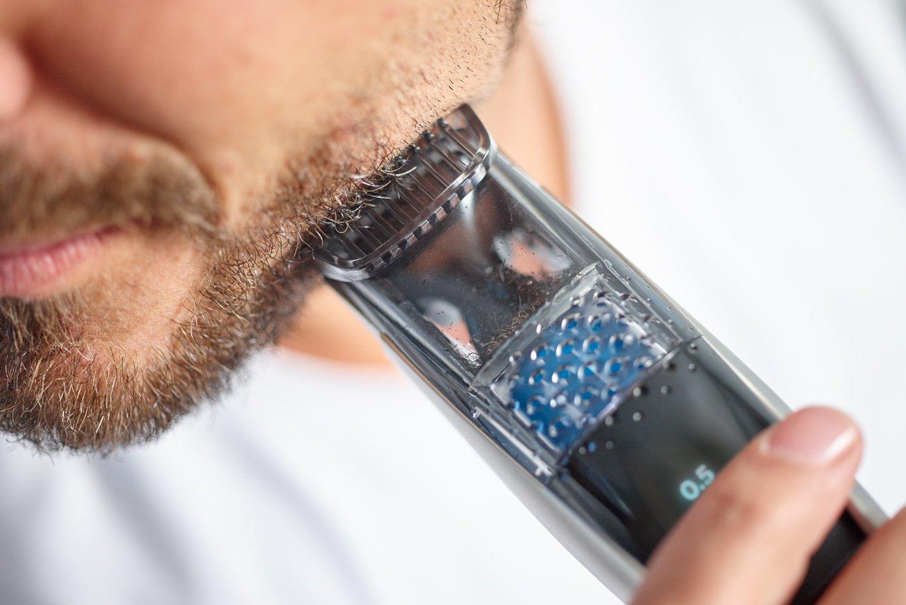 man using a beard trimmer