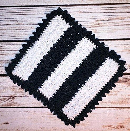 Scrubbing Bobble Dishcloth. Long lasting contemporary black and white with black border and color blocked body. Unique bobble crochet stitch for extra scrubbing power.