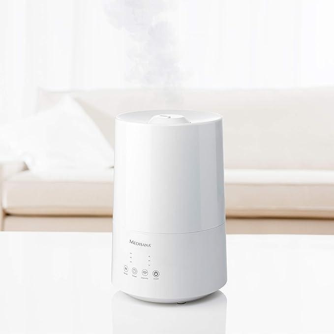 Medisana AH 661 Humidificador ultrasónico, purificador de aire para dormitorio y sala de estar, nebulizador con compartimento de aromas y función de calefacción ...