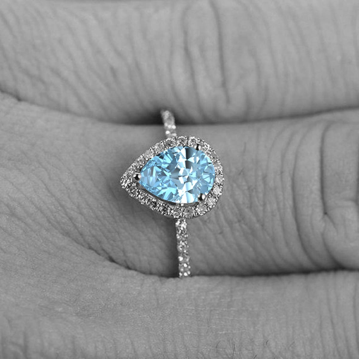 1.50 Ctw Pear Shaped Created Gemstone 14k White Gold Over .925 Sterling Silver Engagement Ring for Womens