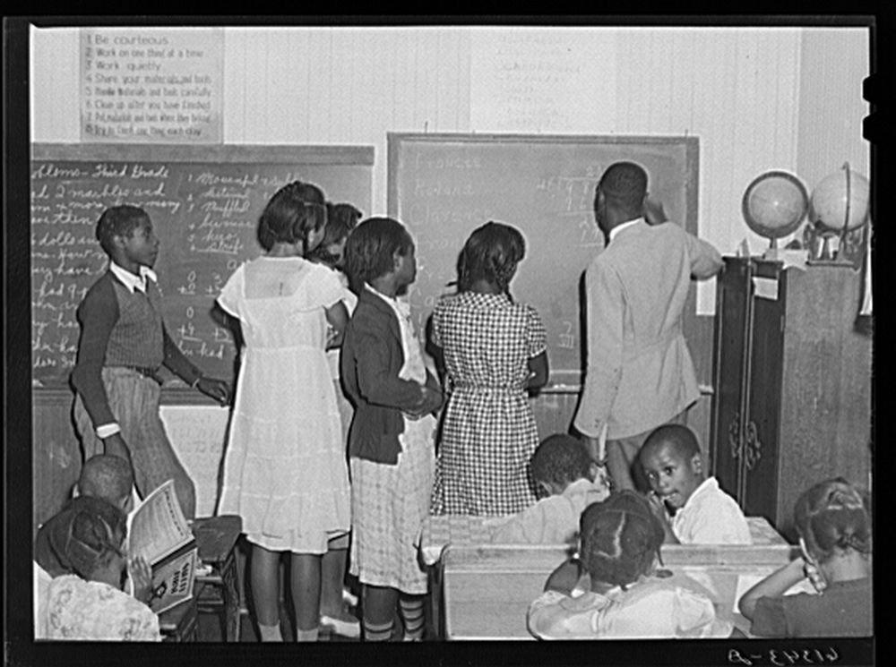 Teacher explaining decimals to seventh grade students. One-room schoolhouse, Saint Mary's County, Maryland
