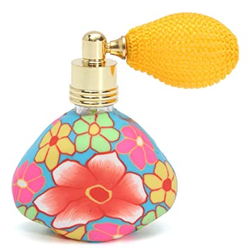 Amazon.com: Airbag atomizador de perfume spray Botella Flor ...
