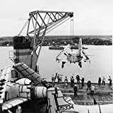 Home Comforts is swung out to be placed on a barge alongside the U.S. Military Sealift Command aircraft transport