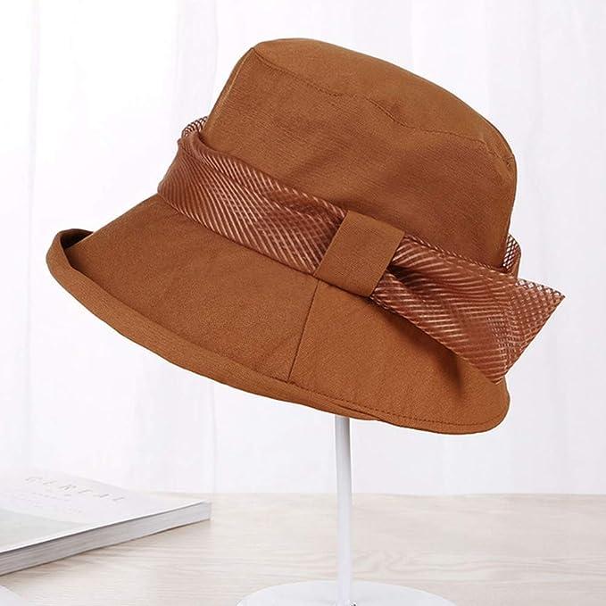 43f9faf9e0e Amazon.com   DOMREO Beach Hat All-Match Basin Cap Women Sun Hat Wide Brim  Stripe Bowknot Anti-uv Sunproof Outdoor Casual Travel Ladies Hats   Sports    ...