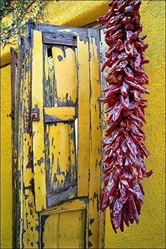 Art decor photograph of yellow wooden window shutters with dried red peppers on Southwest yellow adobe wall in the Barrio historic of Tucson, AZ ()