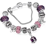 A 925 silver bracelet adorned with Pandora elements, beads, roses and a silver crown with a pendants shaped like a…