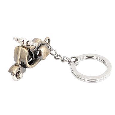 Llavero con cadena tono bronce colgante metálico de forma de ...