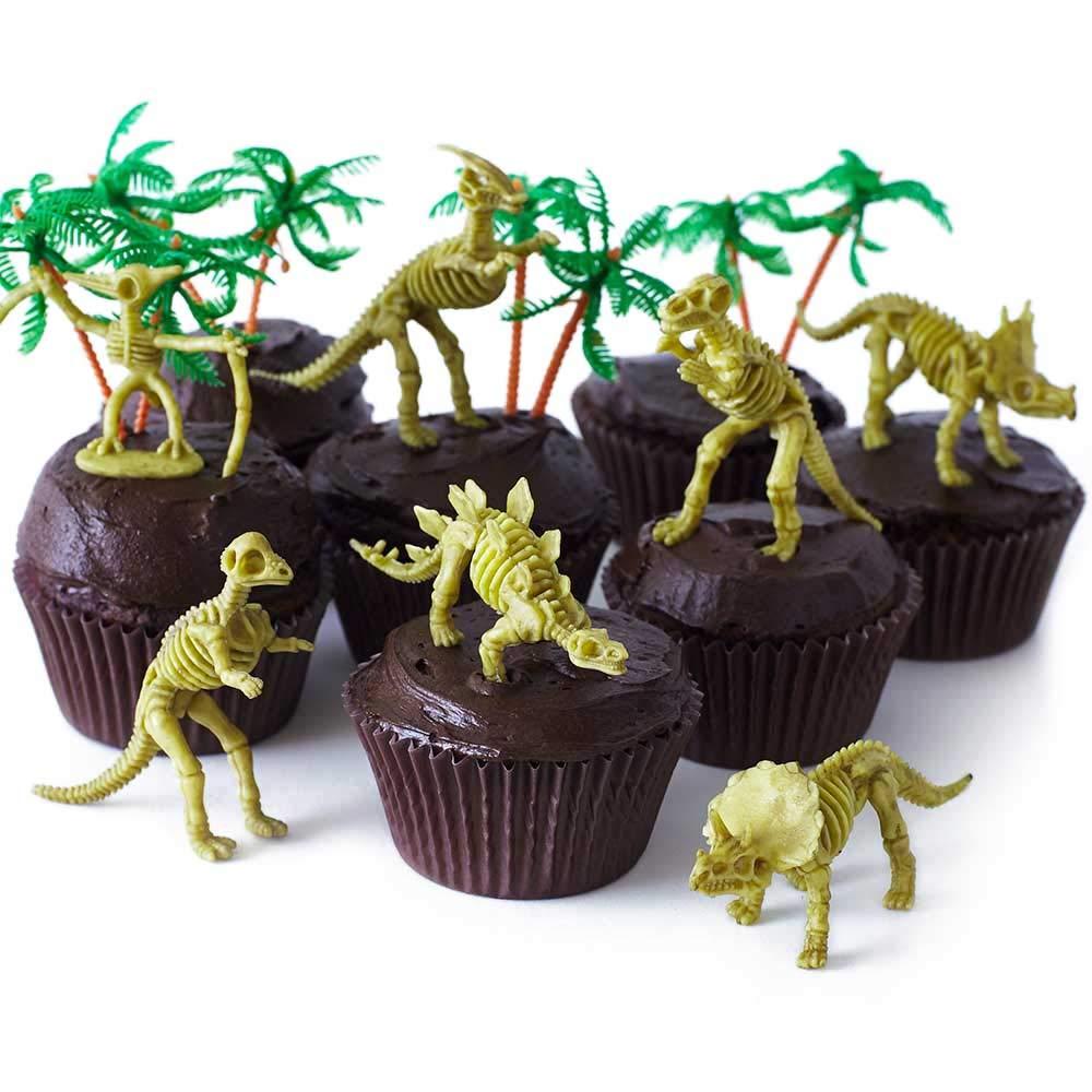 Cakegirls (24) Dinosaur Bones Cupcake Toppers Kit - (12) 3 1/2'' Dinosaur Skeletons Fossils Assorted T-Rex, Triceratops, Stegosaurus (12) 3'' Palm Trees (30) Brown Grease Proof Cupcake Liners by Cakegirls