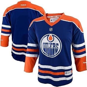 Reebok – Camiseta de hockey de la NHL Edmonton Oilers Jersey infantil 2 –  4T Azul 8f4836abfbe