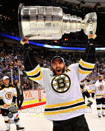 Patrice Bergeron - holding the 2011 Stanley Cup Trophy - NHL 8x10 Photo (Boston Bruins)