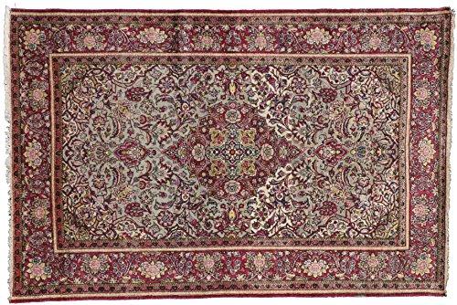 Kashan handmade area rug with greens and burgundies. Size: 4' 5 x 6' 7
