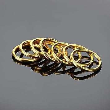 20 anillas redondas de metal dorado abiertas. De ...