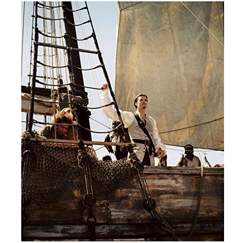 Pirates of the Carribean Orlando Bloom as Will Turner Standing Tall One Arm Raised Over Head 8 x 10 Inch Photo