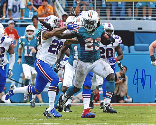 - Jay Ajayi Autographed Breaking a Tackle 8x10 Photo