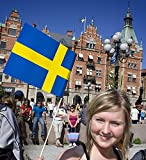 Young woman holding a Swedish flag and smiling, Sweden, Sundsvall 30x40 photo reprint
