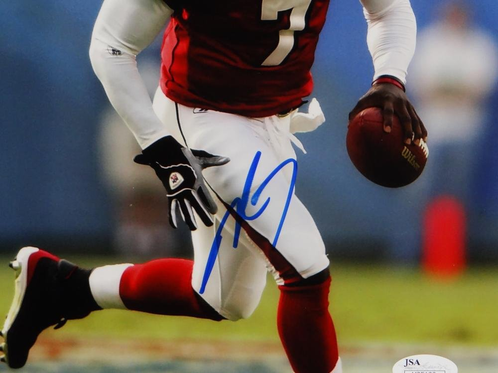 3adc5210df5 Michael Vick Autographed Atlanta Falcons 8x10 Running Red Jersey Photo- JSA  Auth Blue at Amazon s Sports Collectibles Store