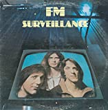 FM: Surveillance LP VG++/NM Canada Passport PB 2001