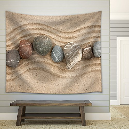 Striped Stones on the Sand Can Be Used as Background Fabric Wall