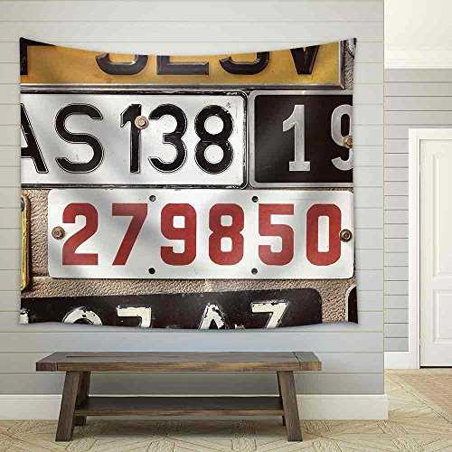 Sepia Toned Image of Old Number Plates on a Metal Garage Door Fabric Wall Tapestry