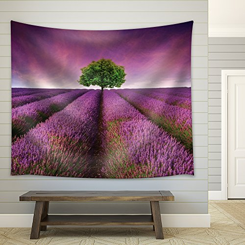 Lone Tree on a Purple Field Covered with Flowers