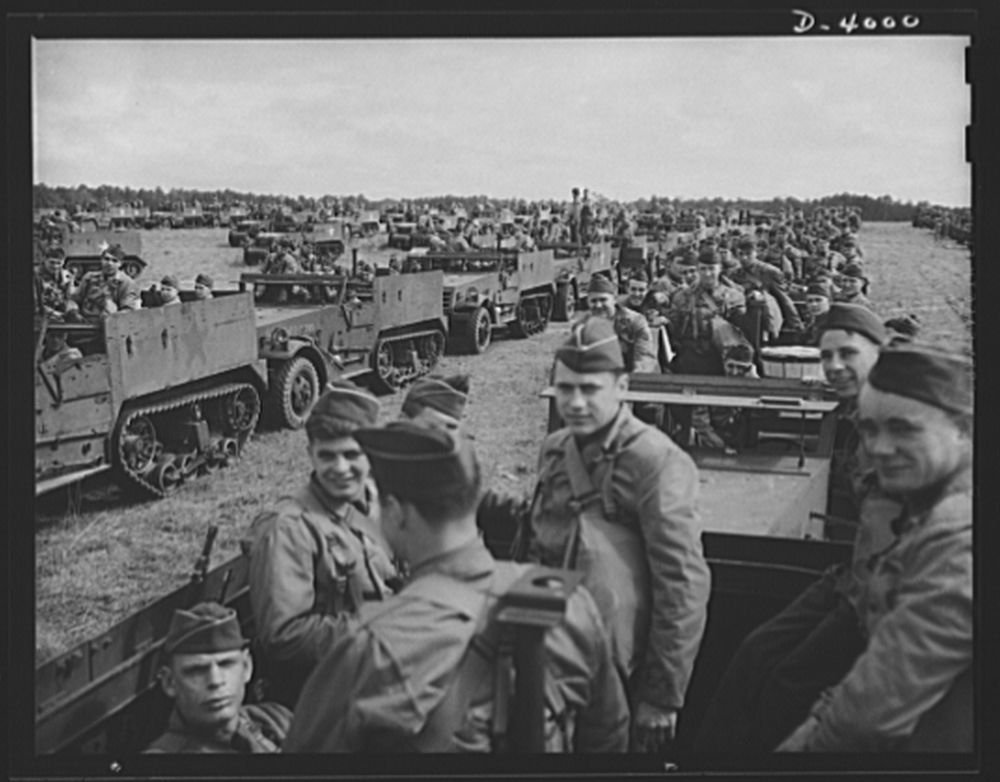 1942 Photo Fort Benning. Halftrac scout cars. America's irresistable might grows every day. Soldiers of the armored forces training in halftrac scout cars at Fort Benning, Georgia are turning rapidly