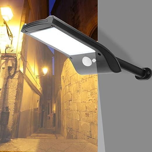 AUNMAS 36 LED de energía Solar de Pared de luz Exterior Impermeable de Movimiento inalámbrico de Seguridad Sensor de luz Nocturna Lámpara de jardín Cubierta de jardín para el hogar: Amazon.es: Hogar