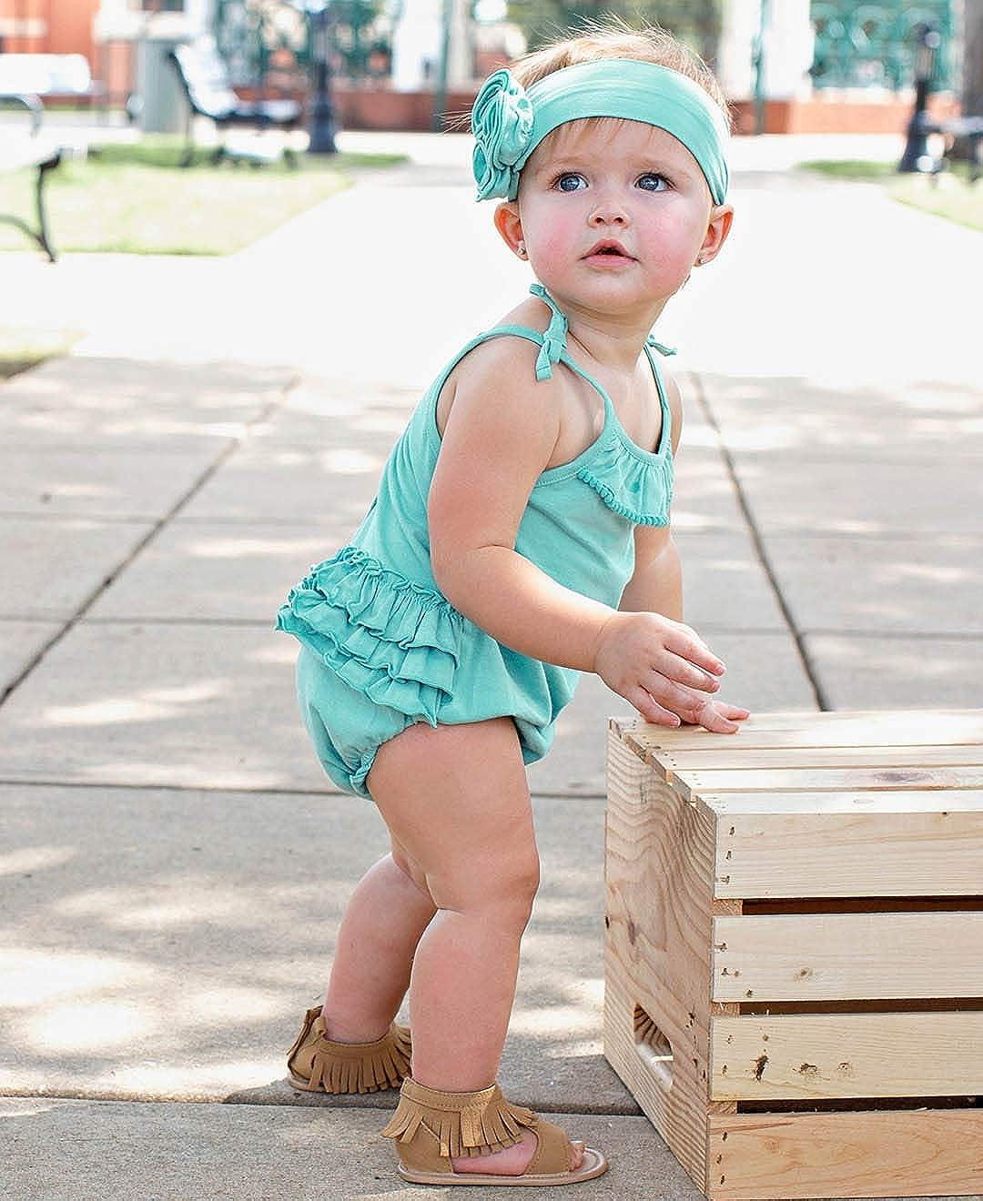 f80fcd1923c4 Amazon.com  RuffleButts Baby Toddler Girls Knit Pom Pom Bubble Romper  w Ruffles  Clothing
