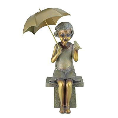 golden girl with bird under umbrella