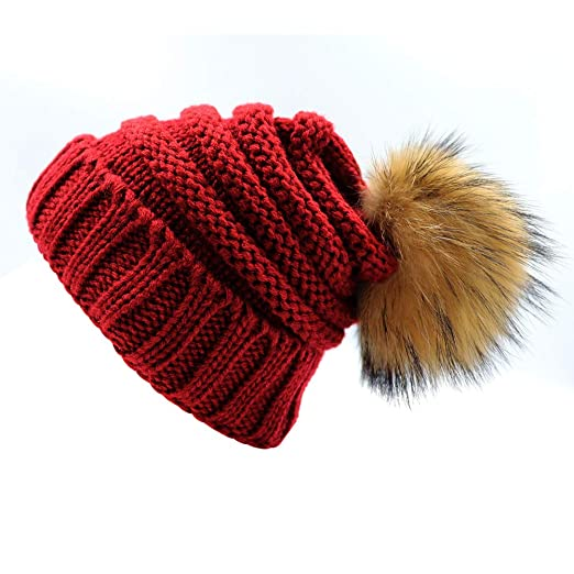 f0119babc3b Amazon.com  Kids Knit Slouchy Beanie Hats Chunky Stretchy Winter Bobble Hat  Knitted Raccoon Faux Fur Ball Pom Pom Cap for Child Wine Red  Clothing