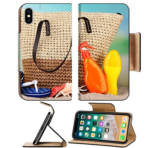 MSD Premium Apple iPhone X Flip Pu Leather Wallet Case IMAGE ID: 32311270 Summer wicker bag with accessories on sand on nature background