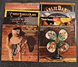 8 different charlie daniels lps: million mile reflections, volunteer jam III and IV, uneasy rider, fire on the mountain, te john grease & wolfman, me and the boys, nightrider, midnight wind