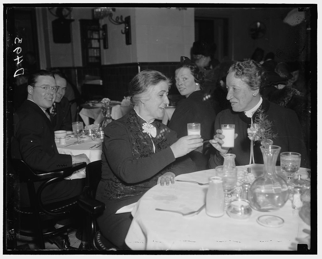 Reproduced 8 x 10 Photo of: A Toast. Washington, D.C., Jan. 6. A ''Milktoast'' From A Veteran To A Rookie. Rep. Nan Wood Honeyman, Member Of The House From Oregon, And Rep. Caro 1938 Harris & Ewing a74